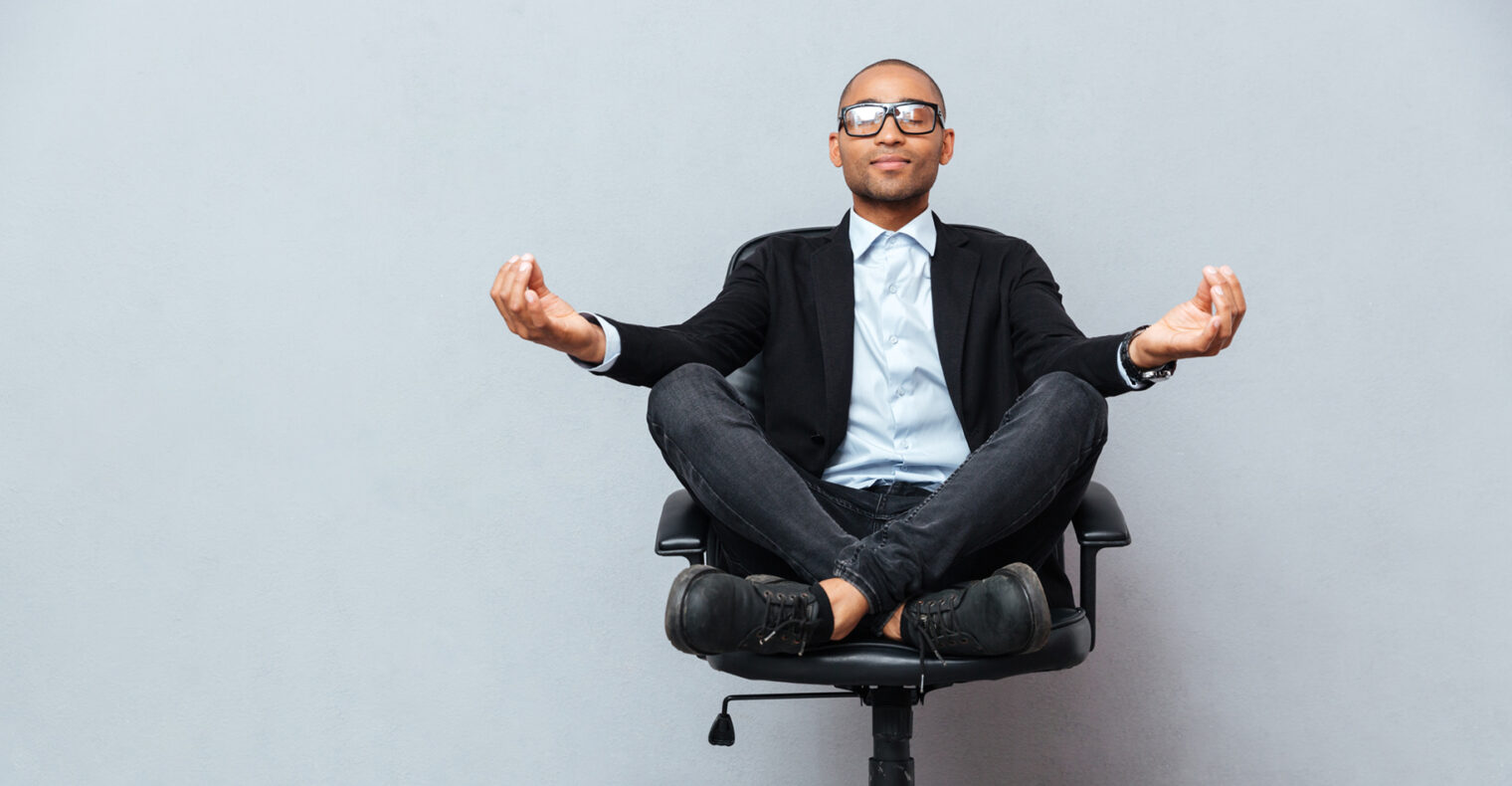 Man meditating in an office chair